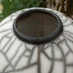 Pièce de poterie réalisée en cuisson raku